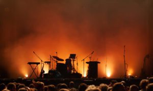 empty concert stage on music festival, instruments silhouettes