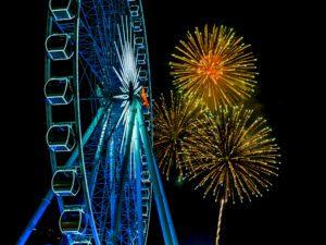 Ferris wheel illuminated at a carnival at night