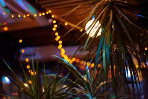 tropical bar athmocphere background with yellow garland bokeh. vacation night life concept.